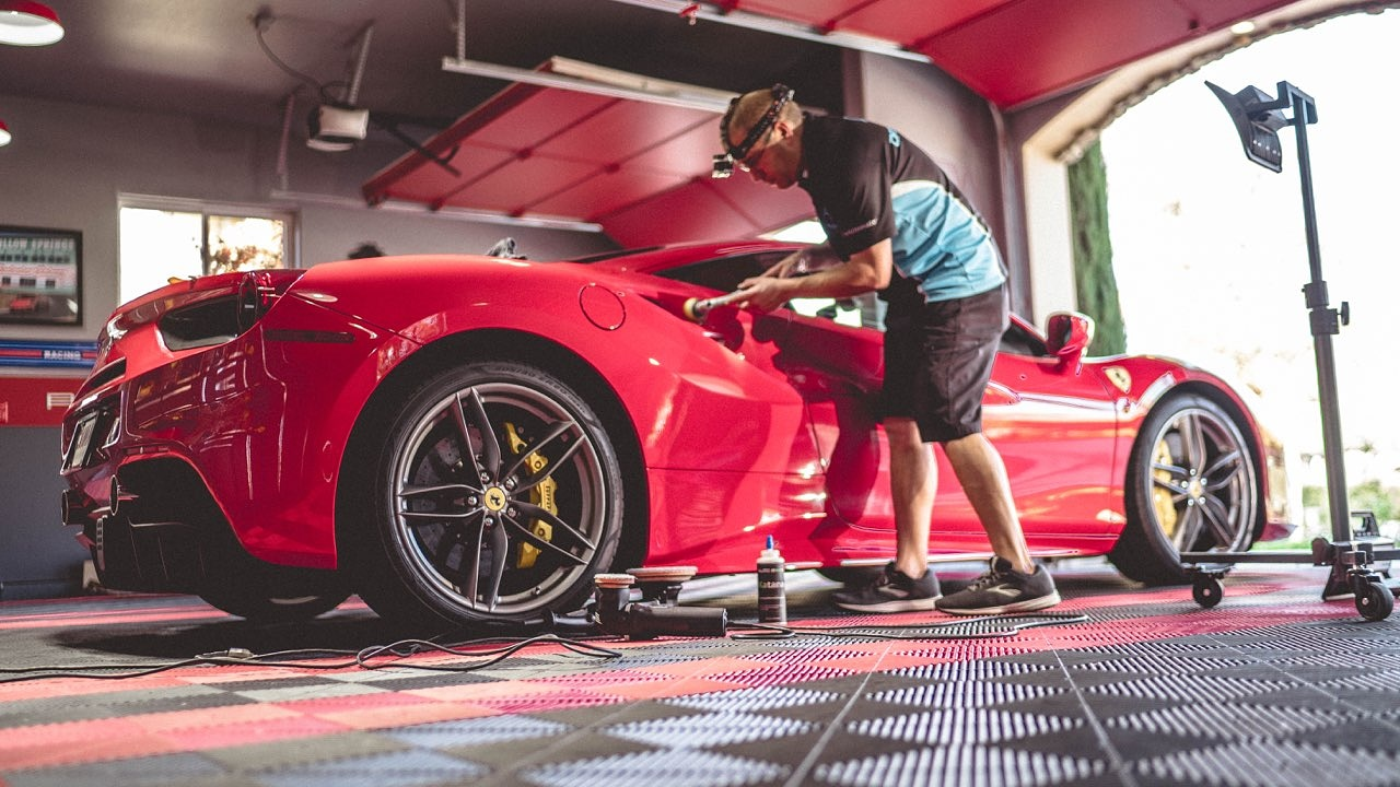 Installing ceramic coating on a Ferrari for paint protection in Clovis, CA